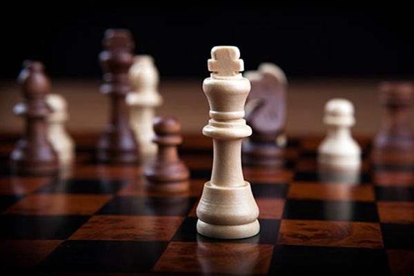 Close up of chess pieces on a chess board.