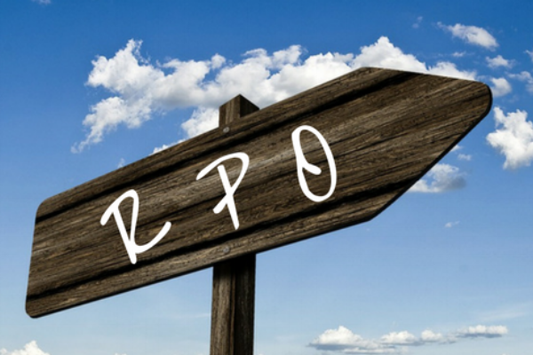 Wooden sign with RPO in white on it.